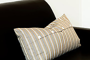 striped pillow on the sofa, close-up