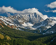 A summer valley leads to a winter peak on a perfect afternoon.