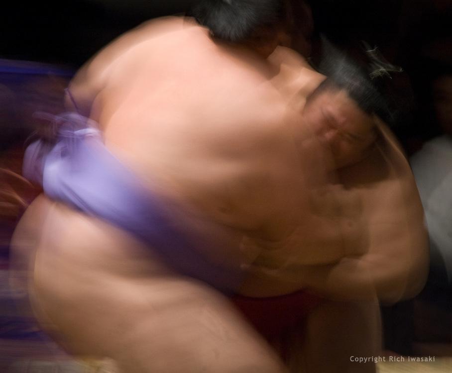 Blurred action view of Kotonowaka (left) wrestlling with Wakatoba at the 2005 Grand Sumo Championship Las Vegas tournament, Mandalay Bay Resort & Casino, Las Vegas, Nevada