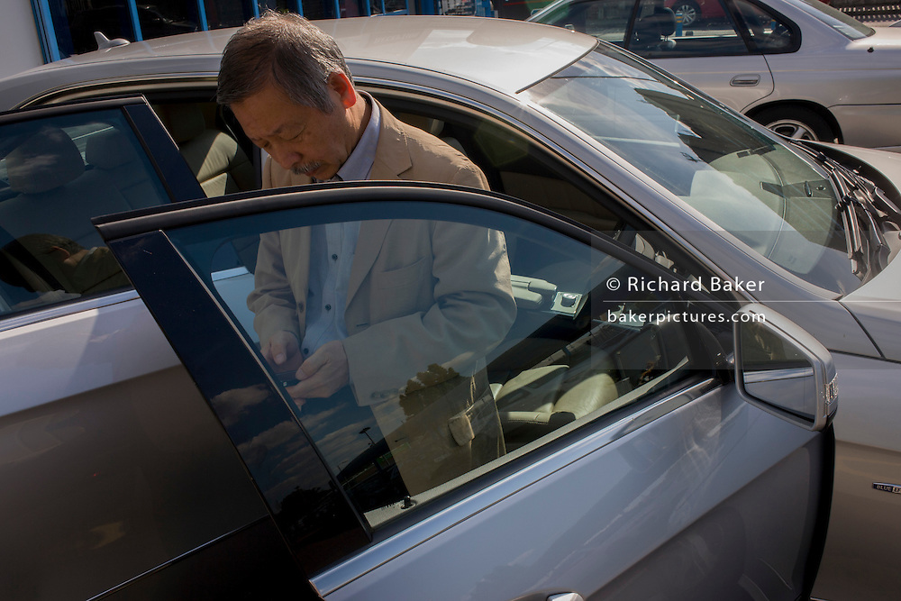 Japanese entrepreneur, Tetsuro Hama at his north London car dealership business. <br /> <br /> From the chapter entitled 'The Price of Happiness' and from the book 'Risk Wise: Nine Everyday Adventures' by Polly Morland (Allianz, The School of Life, Profile Books, 2015).
