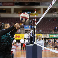 Navajo Prep's Aiona Johnson (16) bumps the ball during their match against Tularosa Friday morning at the Santa Ana Star Center in the NMAA Class 3A State Volleyball tournament in Rio Rancho. Navajo Prep Eagles swept the Tularosa Wildcats in straight sets.