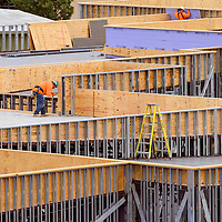 Builders work on the roof structure at the construction site of the Jefferson Elementary School expansion Wednesday in Gallup.