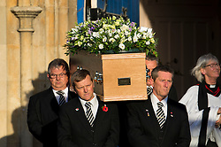 © Licensed to London News Pictures. 13/11/2015. London, UK. The coffin leaving the church after The funeral of former Labour MP Michael Meacher at St Mary's Church in Wimbledon, south west London.  Michael Meacher, who was a Labour MP in Oldham for over 40 years, served as Minister of State for the Environment in the Tony Blair government.  Photo credit: Ben Cawthra/LNP