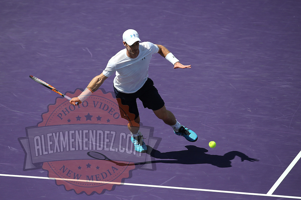 Andy Murray of Great Britain returns hits the ball from Santiago Giraldo of Columbia during their match at the Miami Open tennis tournament on Sunday, March 29, 2015 in Key Biscayne, Florida. (AP Photo/Alex Menendez)