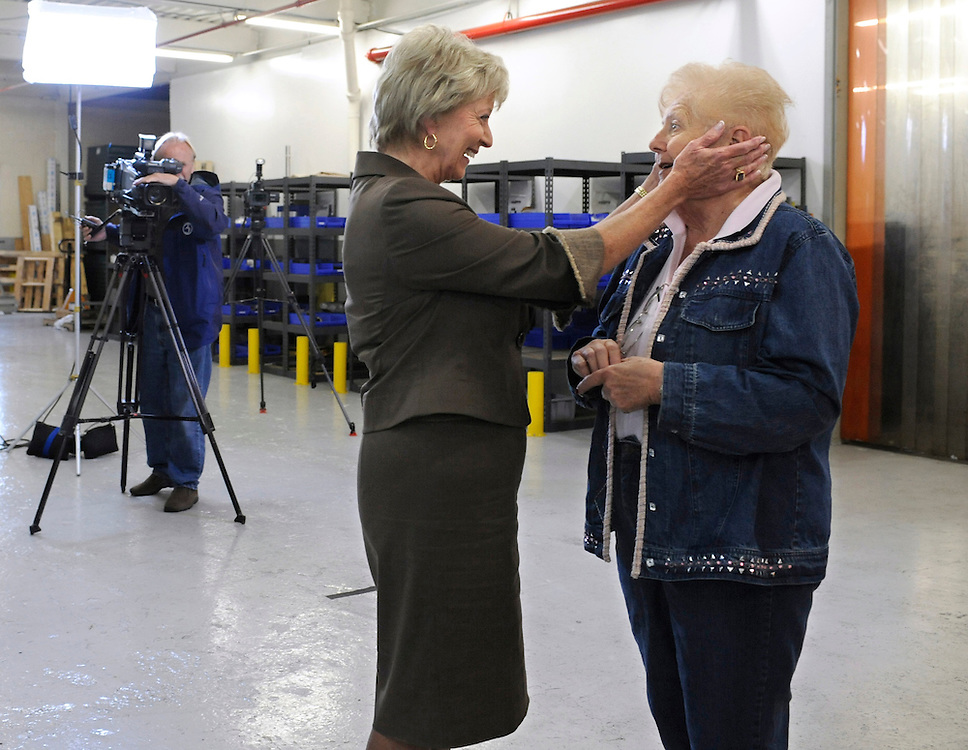 Former wrestling executive Linda McMahon, left, greets supporter Jeannette Hinkson of Plainville, Conn., before a series of one-on-one interviews with the media in Southington, Conn. McMahon announced her plan to seek for a second time the Republican endorsement for Connecticut's U.S. Senate seat being vacated by independent Sen. Joe Lieberman.  (AP Photo/Jessica Hill)