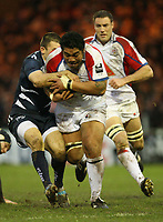 Photo: Rich Eaton.<br /> <br /> Sale Sharks v Bristol Rugby. Guinness Premiership. 01/01/2007. Alfie To'oala of Bristol is tackled by Chris Bell of Sale