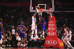 October 19, 2018 - Los Angeles, CA, U.S. - LOS ANGELES, CA - OCTOBER 19: Oklahoma City Thunder Forward Paul George (13) misses a dunk over Los Angeles Clippers Center Montrezl Harrell (5) during a NBA game between the Oklahoma City Thunder and the Los Angeles Clippers on October 19, 2018 at STAPLES Center in Los Angeles, CA. (Credit Image: © Brian Rothmuller/Icon SMI via ZUMA Press)