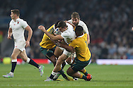 Jonny May of England is hauled down by Tevita Kuridrani of Australia and Will Genia of Australia. Rugby World Cup 2015 pool A match, England v Australia at Twickenham Stadium in London, England  on Saturday 3rd October 2015.<br /> pic by  John Patrick Fletcher, Andrew Orchard sports photography.