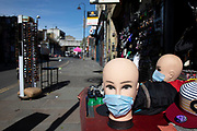Brick Lane almost deserted due to Covid-19 as face masks are on sale on what would normally be a busy, bustling market day with hoards of people out to shop, eat and socialise on 22nd March 2020 in London, England, United Kingdom. All of the East End Sunday markets have been affected by the Coronavirus outbreak, with some completely closed and some currently partially open. Coronavirus or Covid-19 is a new respiratory illness that has not previously been seen in humans. While much or Europe has been placed into lockdown, the UK government has announced more stringent rules as part of their long term strategy, and in particular social distancing.