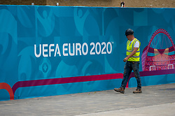 © Licensed to London News Pictures. 10/06/2021. LONDON, UK.  A workman inspecting signage around Wembley Stadium for the upcoming 2020 UEFA European Football Championship, commonly known as Euro 2020.  The tournament was postponed from 2020 due to the COVID-19 pandemic in Europe and rescheduled for 11 June to 11 July 2021 with matches to be played in 11 cities in 11 UEFA countries.  Wembley Stadium will host certain group matches including England v Croatia on 13 June, as well as the semi-finals and final itself.  Photo credit: Stephen Chung/LNP