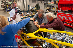 Arlen Ness in his shop working on the Top Banana Biker Build-Off bike with his longtime mechanic Jeff Border as Loy Norrix films them. Dublin, CA. 2004. Photograph ©2004 Michael Lichter