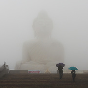 Mist over the Big Buddha monumet during rain on Phuket, Thailand