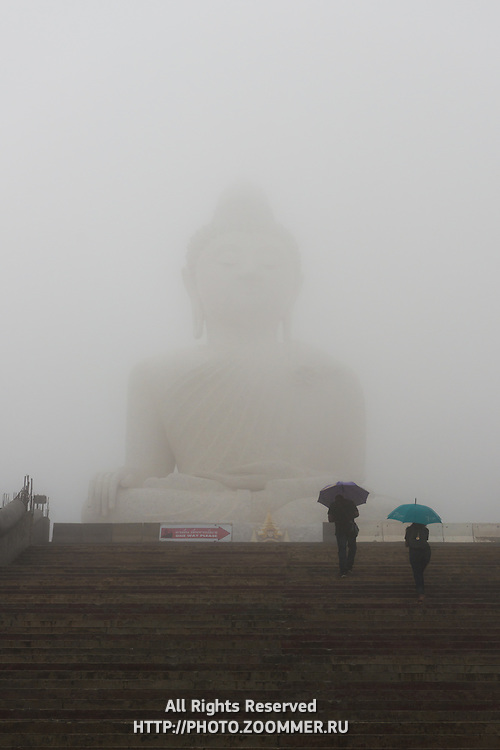 Mist over the Big Buddha monumet during rain on Phuket, Thailand