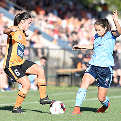 BRISBANE, AUSTRALIA - OCTOBER 30: Angela Beard of the Roar and Servet Uzunlar of Sydney compete for the ball during the round 1 Westfield W-League match between the Brisbane Roar and Sydney FC at Spencer Park on November 5, 2016 in Brisbane, Australia. (Photo by Patrick Kearney/Brisbane Roar)
