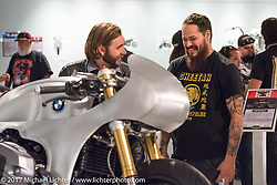Custom builder Cristian Sosa and Mark Buche of BMW talk at the Old Iron - Young Blood exhibition media and industry reception in the Motorcycles as Art gallery at the Buffalo Chip during the annual Sturgis Black Hills Motorcycle Rally. Sturgis, SD. USA. Sunday August 6, 2017. Photography ©2017 Michael Lichter.