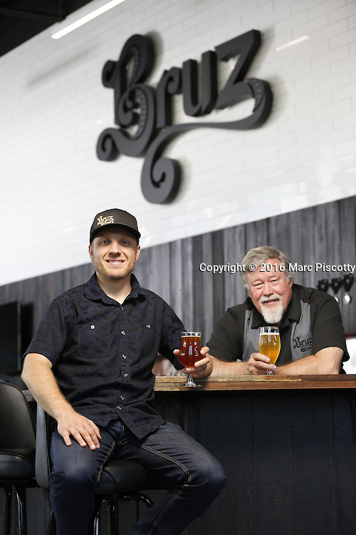 SHOT 7/22/16 1:48:14 PM - Bruz Beers co-founders Charlie Gottenkieny and Ryan Evans inside the new brewery near 67th Avenue and Pecos in Denver, Co. Bruz Beers is Denver's artisanal Belgian-style brewery, featuring a full line of traditional and Belgian-inspired brews, hand-crafted in small batches. Includes images of Evan's dog 'Cooper' as well who serves as the brewery dog. (Photo by Marc Piscotty / © 2016)