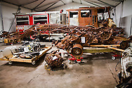 Destroyed emergency response vehicles that are part of a collection of artifacts saved from the site of the World Trade Center after 9/11. Artifacts chosen by curators out of the wreckage  from the World trade Center  stored temporarily within an 80,000 square foot hanger at JFK airport, Hanger 17. Some of the artifacts will be in the National September 11 Memorial Museum set to open in 2012.