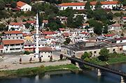 a newly buiolt mosque on the bansk of the River Bojana and  the Old Buna Bridge Shkodër, Albania. 02Sep15.