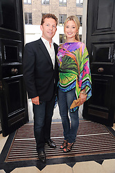 NICK CANDY and HOLLY VALANCE at a party to celebrate the launch of Page One an online guide to London's 100 most rewarding restaurants held at the Halcyon Gallery, Bruton Street, London on 7th July 2010.