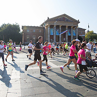 Participants run in front of the Arts Hall on Heroes square during the Budapest Half Marathon in Budapest, Hungary on September 13, 2015. ATTILA VOLGYI