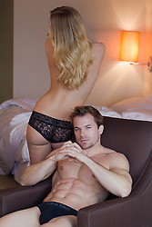sexy man in in briefs with details of  woman's beautiful body nearby