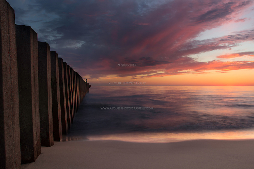 A colorful light adorns the clouds after sunset as viewed from North Pier in South Haven