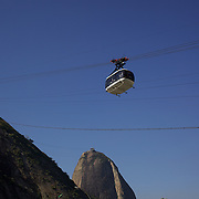 Cable cars taking tourists and sightseers to and from the top of Sugar Loaf Mountain, one of the iconic tourist destinations in Rio de Janeiro. Rio de Janeiro, Brazil. 24th August 2010. Photo Tim Clayton