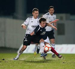 Livingston's Burton O'Brien and Falkirk's Thomas Grant..Falkirk 2 v 0 Livingston, 19/2/2013..©Michael Schofield.