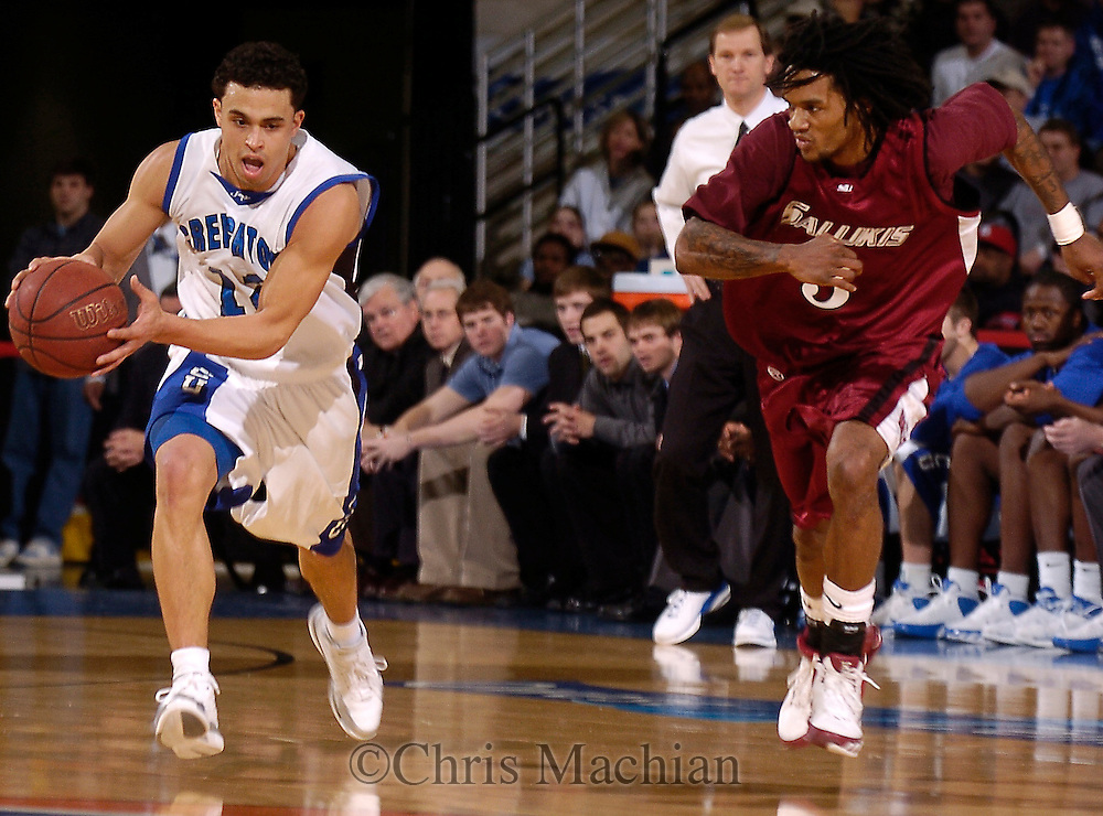 2/11/06 -- Omaha, Ne Creighton University's Josh Dotzler  drives the ball past Southern Illinois University's Jamaal Tatum..(Photo by Chris Machian/Prarie Pixel Group).