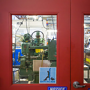 The red door entrance into the machine shop division of Chris King Precision Components.