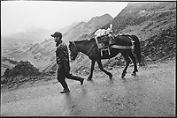 A man walks his horse along the lone main road that travels through Ha Giang Province in northern Vietnam.