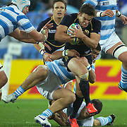 Max Evans, Scotland, is tackled by Nicolas Vergallo, Argentina, during the Argentina V Scotland, Pool B match at the IRB Rugby World Cup tournament. Wellington Regional Stadium, Wellington, New Zealand, 25th September 2011. Photo Tim Clayton...