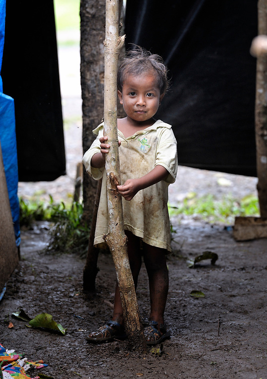 This child is one of several dozen residents of the indigenous village of San Fernando who fled their home on March 14, shortly after the March 5 assassination of Jimmy Liguyon, their baranguay captain. Liguyon was killed by a paramilitary squad led by Aldy Salusad, which was angered by Liguyon's refusal to sign papers ceding the community's land to a large mining company. Convinced they were also in danger from Salusad and his military allies, community members fled to the provincial capital of Malaybalay, where they have set up temporary shelters on the grass in front of provincial offices. They promise not to leave until there is justice in the killing of Liguyon..