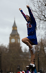 © London News Pictures. 01/01/2012. London, UK. All American Cheerleaders from USA perform to a medley of songs from Beyonce in front of The Houses of Parliament at the 2012 New Years Parade in London on January 1st, 2012. Photo credit : Ben Cawthra/LNP