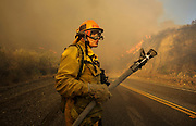 A firefighter watches a wildfire burning along the Placenta Canyon Road in Santa Clarita, Calif., Sunday, July 24, 2016.(AP Photo/Ringo H.W. Chiu)