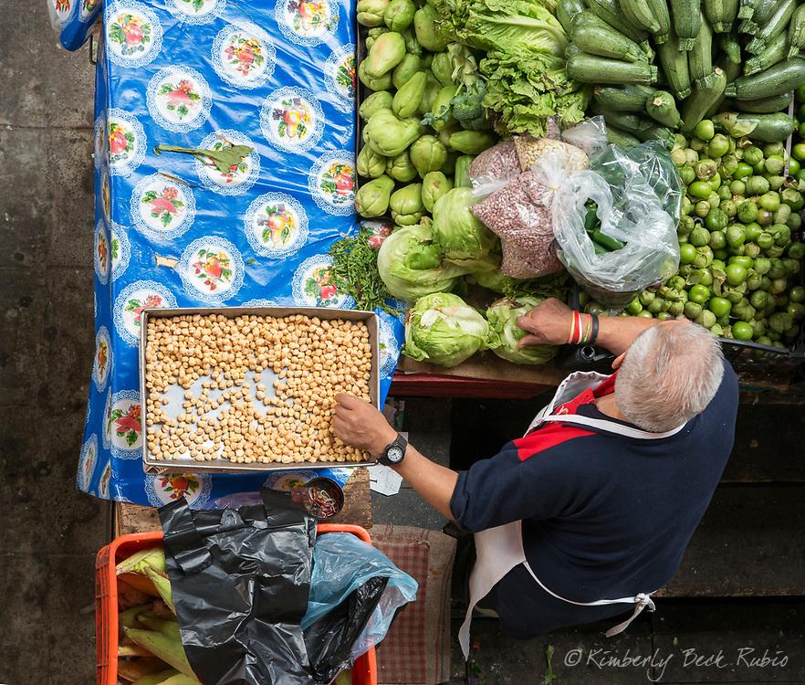 Produce vendor in his stall at Mercado Hidalgo (Hidalgo Market), the central market in Guanajuato, Mexico.