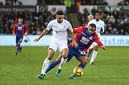 Neil Taylor of Swansea City and Jason Puncheon of Crystal Palace during the Premier League match between Swansea City and Crystal Palace at the Liberty Stadium, Swansea, Wales on 26 November 2016. Photo by Andrew Lewis.