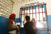 Parents collect their children's prescriptions for free at the Ola During Children's Hospital in Freetown on Tuesday April 27, 2010. The Sierra Leone government announced today the abolition of medical fees for pregnant and lactating women as well as children under the age of 5.