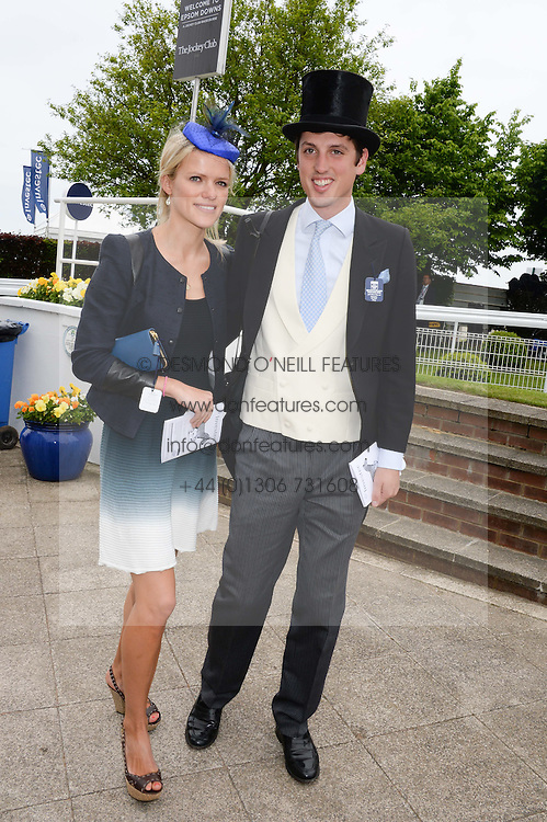 JAKE WARREN and fiancee ZOE STEWART at the Investec Derby 2013 held at Epsom Racecourse, Epsom, Surrey on 1st June 2013.