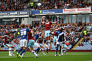Lukas Jutkiewicz of Burnley (c) heads clear. Skybet football league championship match, Burnley  v Birmingham City at Turf Moor in Burnley, Lancs on Saturday 15th August 2015.<br /> pic by Chris Stading, Andrew Orchard sports photography.