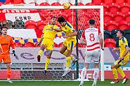 Wimbledon forward Kwesi Appiah (9) clears the danger  during the EFL Sky Bet League 1 match between Doncaster Rovers and AFC Wimbledon at the Keepmoat Stadium, Doncaster, England on 17 November 2018.