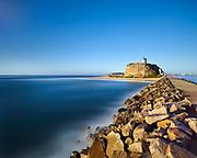 Dawn sunlight washes over Nobby's Headland, Newcastle, NSW, Australia