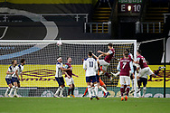 Burnley defender James Tarkowski (5) headder is heading for goal but Tottenham Hotspur forward Harry Kane (10) clears off the line during the Premier League match between Burnley and Tottenham Hotspur at Turf Moor, Burnley, England on 26 October 2020.