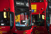 London bus drivers stationary in traffic on the Dulwich route, chat through open windows on their journeys along Walworth Road, on 11th October 2016, in Walworth, south London, England.