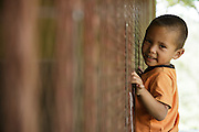 A young boy peeks through a classroom window at the primary school in the town of Coyolito, Honduras on Wednesday April 24, 2013.
