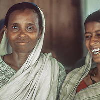 In Bangladesh's brutal 1971 war of independence from Pakistan, hundreds of thousands of women were widowed, left homeless and destitute including this pair of once-middle class woman who six years later still lived at Mirupur Destitute Camp near Dhaka.  1977