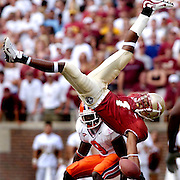 TALLAHASSEE, FL. 9/25/04-CH 13 FSUCLEM26-FSU's Craphonso Thorpe makes a one hand catch but could not hold the ball on impact as Clemson's Justin Miller watches during first half action Saturday at Doak Campbell Stadium in Tallahassee. COLIN HACKLEY PHOTO