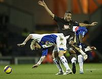 Photo: Aidan Ellis.<br /> Blackburn Rovers v Tottenham Hotspur. The Barclays Premiership. 19/11/2006.<br /> Blackburn's Robbie Savage takes out Spurs Mido