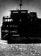 The two dots in the foreground were swimmers who had a water-level view of the ferry Elwha off Edmonds. The boat was headed for Kingston on the Kitsap Peninsula. (Cole Porter / The Seattle Times, 1978)