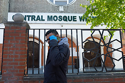 © Licensed to London News Pictures. 22/04/2020. London, UK. A man wearing gloves walks past Wembley Central Mosque on Ealing Road, Alperton. The start of the Muslim observation of Ramadan will begin during the Coronavirus lockdown.  Photo credit: Ray Tang/LNP